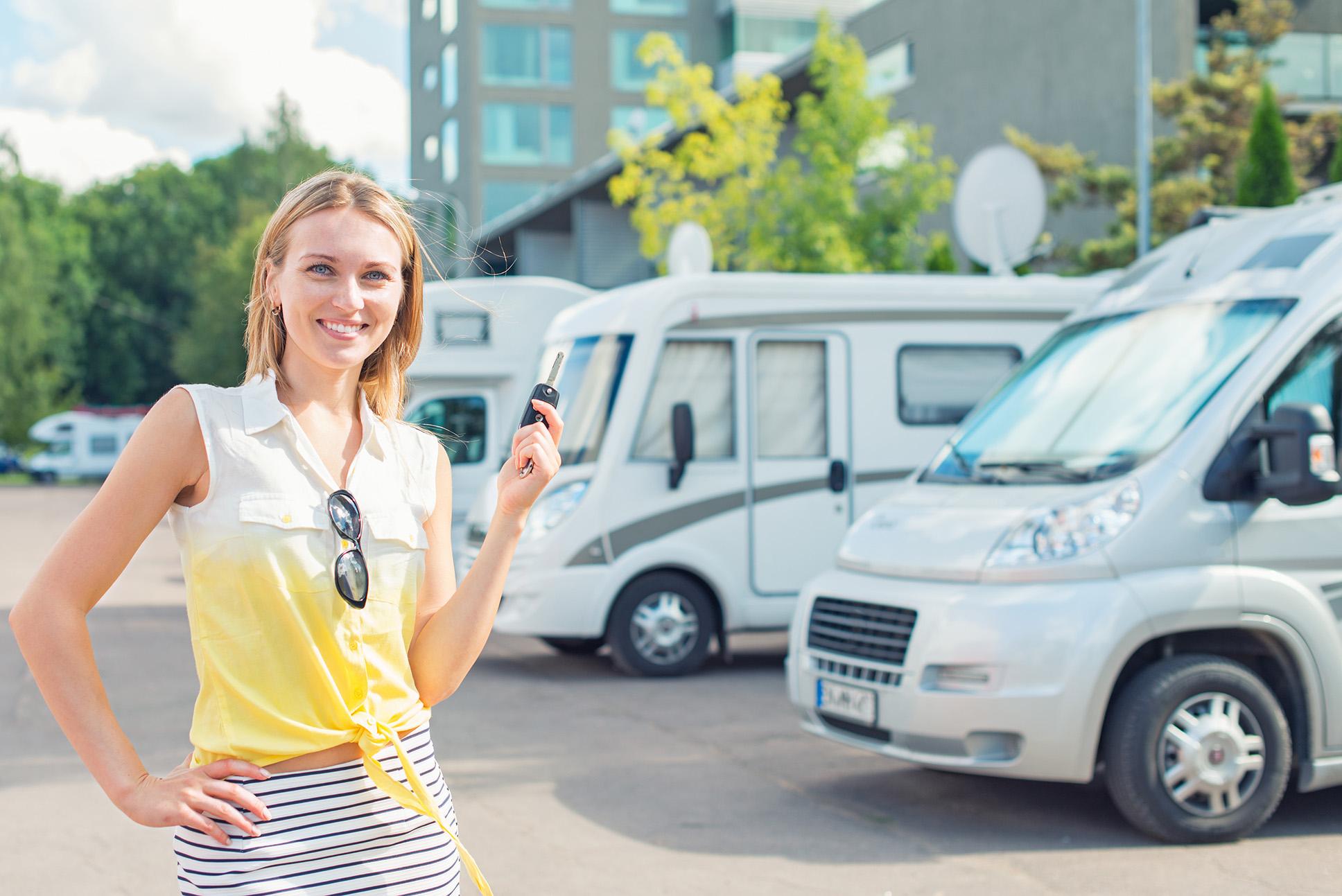 Beautiful young woman offers vans at Los Angeles van rental